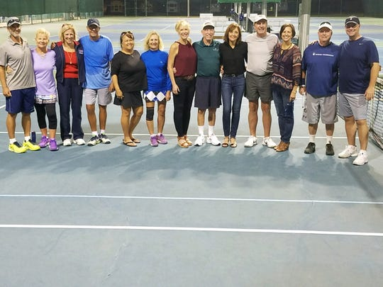 Pensacola-area members from the 1999 USTA National Championship teams celebrated the anniversary at Roger Scott Tennis Center.