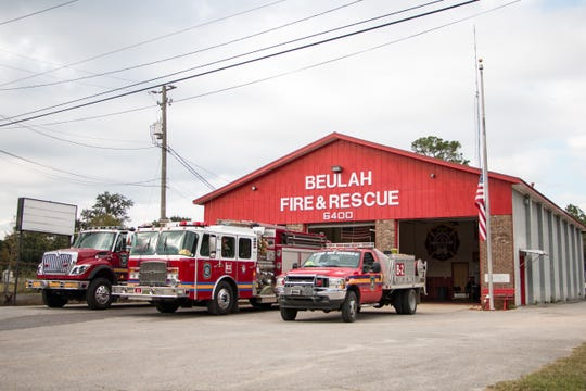 An American flag flies at half staff at the Beulah fire station after Escambia County Volunteer District Fire Chief Dwain S. Bradshaw was killed while he was responding to a fatal car crash on the Alabama state line Wednesday, Nov. 6, 2019.