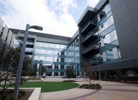 The newest office building on the Navy Federal campus is filling with employees on Wednesday, Nov. 6, 2019. The new six-story office building is nearing completion, with a second six-story building under construction. Once completed, the two-buildings will double the current capacity of the Nine Mile Road campus.