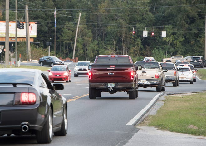 Traffic on Woodbine Road in Pace on Wednesday, Nov. 6, 2019.