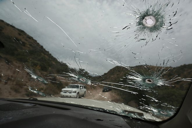 Bullet-riddled vehicles that members of the extended LeBaron family were traveling in sit parked on a dirt road near Bavispe, at the Sonora-Chihuahua state border in Mexico on Nov. 6, 2019. Three women and six of their children, related to the extended LeBaron family, were gunned down in an attack while traveling here Nov. 4.