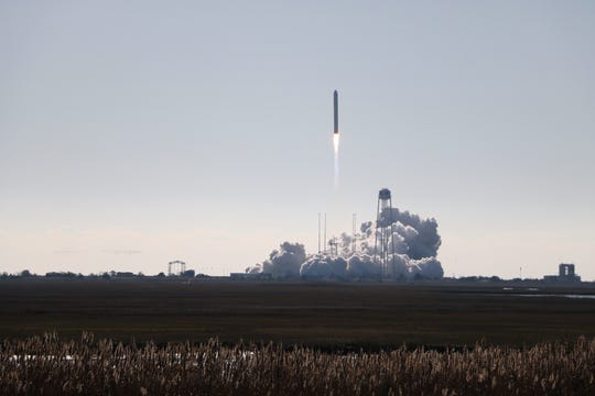 An Antares rocket blasts off from the launchpad at NASA's Wallops Flight Facility in Virginia on Nov. 2, 2019. The rocket sent the Cygnus spacecraft on a resupply journey to the International Space Station, carrying a payload that included seven small satellites made by students at U.S. universities.
