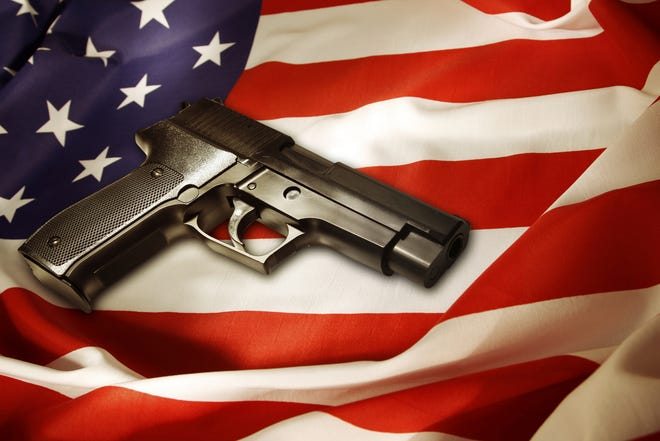 Gun over American flag.