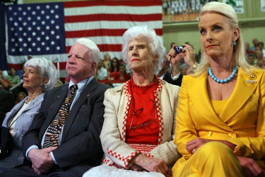 """Republican presidential candidate, Sen. John McCain's family, from left, sister Sandy Morgan, brother Joseph McCain, mother Roberta, and wife Cindy listen as he addresses the crowd during a Speech and Panel Discussion at the Pensacola Junior College during his """"Service to America"""" campaign tour on April 2, 2008, in Pensacola, Florida."""