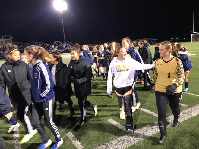 A happy group of Elco girls soccer players leave the field after Tuesday night's 3-0 state playoff win over Lewisburg.