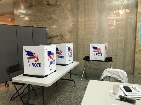 Voting booths at the Lebanon municipal building during Tuesday's election. Just before 5 p.m., less than 100 people had voted at the precinct.