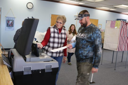 The 500th ballot to be entered at the polling location at Peace Lutheran Church in Port Clinton is submitted on Tuesday afternoon.