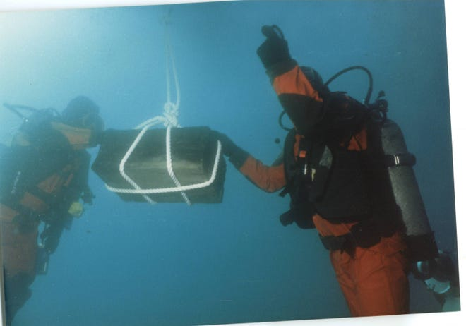 Divers haul cargo from the SS Regina after it was discovered on the bottom of Lake Huron in the mid-1980s.