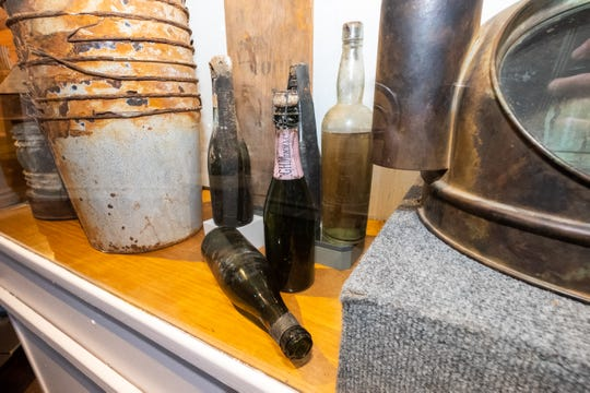 Whiskey bottles brought back from the Regina are displayed in Port Huron Museum's Carnegie Center ahead of its exhibit focusing on the Storm of 1913.