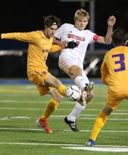 Rhinebeck's Noah Lortie (1) keeps the ball away from Southold's Tyler Woodhull (17) during the boys soccer Class C state regional game at Middletown High School Nov. 5, 2019. Rhinebeck won the game 2-0.