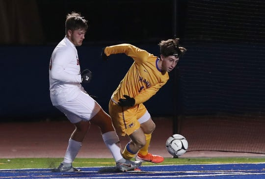 Rhinebeck's Noah Lortie (1) drives to the goal in front of Southold's Nicholas Grathwohl (13) during the boys soccer Class C state regional game at Middletown High School Nov. 5, 2019. Rhinebeck won the game 2-0.