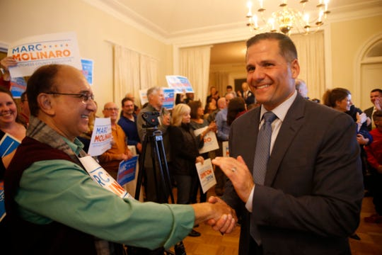 Marc Molinaro enters the room during the Dutchess County Republican Party celebration at the Poughkeepsie Tennis Club on November 5, 2019.