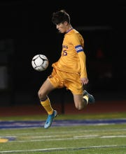 Rhinebeck's Colin Murray looks to control the ball during a Class C soccer regional semifinal against Southold on Nov. 5.