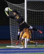 Rhinebeck goalkeeper Brendan Hines (30) makes a save against Southold during the boys soccer Class C state regional game at Middletown High School Nov. 5, 2019. Rhinebeck won the game 2-0.