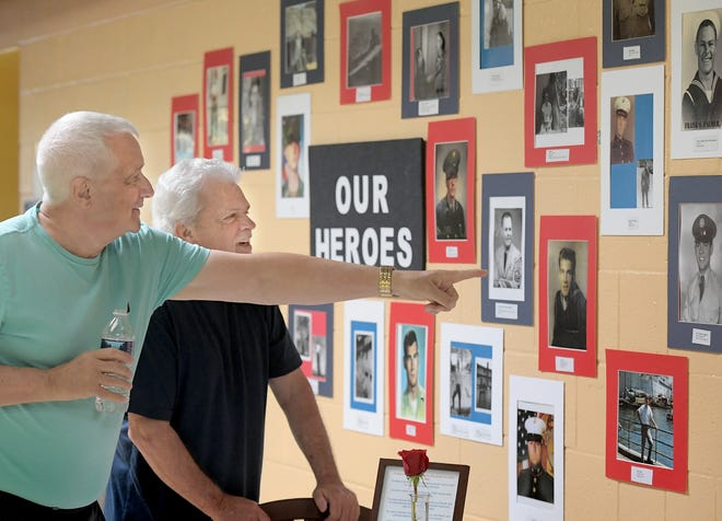 Army veteran Bob Heyne, left, and Bob Tedore, both of New Freedom, look at service-era photos of attending veterans during a Veteran Service Event sponsored by the YMCA's Southern Community Services program at it's Shrewsbury facility Wednesday, November 6, 2019. It's the second veterans event sponsored by the YMCA and is designed to introduce beneficial programs available to veterans. A breakfast and door prizes were offered during the event. Bill Kalina photo