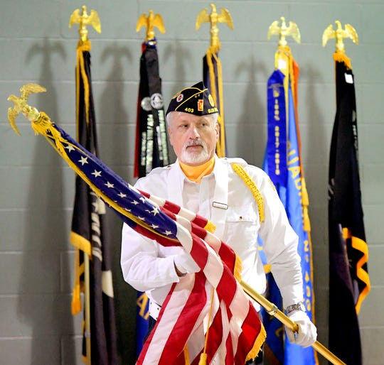 Mike Bortner of Glen Rock American Legion Post #403 prepares to present the colors with a post guard unit during a Veteran Service Event sponsored by the YMCA's Southern Community Services program at it's Shrewsbury facility Wednesday, November 6, 2019. It's the second veterans event sponsored by the YMCA and is designed to introduce beneficial programs available to veterans. A breakfast and door prizes were offered during the event. Bill Kalina photo