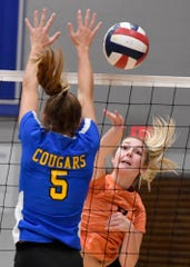 Central York's Alexa Shorts, right, drives a kill past Brooke Lauletta of Downingtown East during the PIAA Class 4-A first-round match, Tuesday, November 5, 2019.