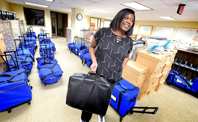 York County Elections and Voter Registration Director Nikki Suchanic holds a bag of ballots while standing amid cases loaded with them in the Elections Office at the York County Administrative Center Wednesday, November 6, 2019. Problems with the new voting procedures on Election Day required the ballots to be rescanned. Bill Kalina photo