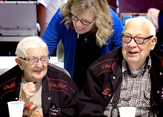 Navy veteran Austin Bollinger and his wife Margaret, of Shrewsbury, talk with Susan Eckhart, YMCA director of Famity services, during a Veteran Service Event sponsored by the YMCA's Southern Community Services program at it's Shrewsbury facility Wednesday, November 6, 2019. Austin served in WWII in the Navy Seabees, a naval construction battalion. The 93-year-old couple has been married 68 years. It's the second veterans event sponsored by the YMCA and is designed to introduce beneficial programs to veterans. A breakfast and door prizes were offered during the event. Bill Kalina photo