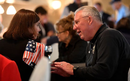 Senator Kristen Phillips-Hill, left, and York County Sheriff Rich Keuerleber chat while waiting for the general election results, Tuesday, November 5, 2019.