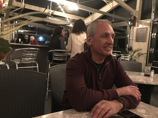 York County sheriff candidate Shane Becker sits at the Stone Grille & Taphouse in York Township on Tuesday while awaiting results.
