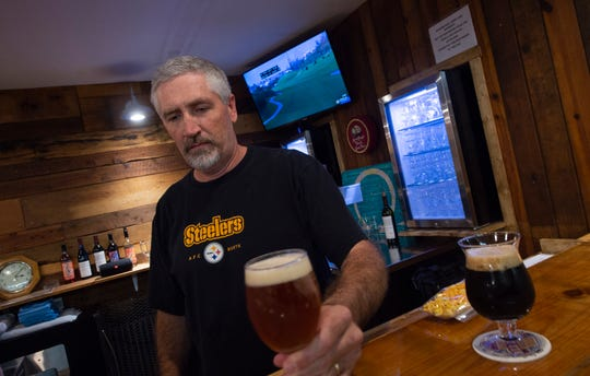 Red Lion Alesmiths co-owner Ed Miller sets a pint of Amber Wave on the bar at Red Lion Alesmiths. The brewery, which opened in Sept. 2019, is located inside The Hub at 157 E. Broadway in Red Lion.