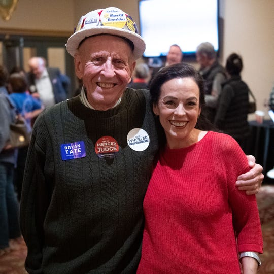 Commissioner candidate Julie Wheeler poses with a supporter on Election Day, November 5, 2019.