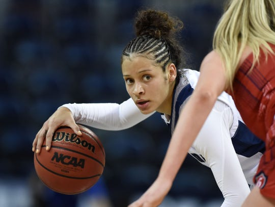 Nevada's Essence Booker looks to pass the ball against Saint Mary's Sam Simons late the second half of Tuesday's game at Lawlor Events Center. Nevada won 78-72.