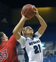 Nevada's Imani Lacy shoots with Saint Mary's Claire Ferguson covering her from behind during Tuesday's game at Lawlor Events Center. Nevada won 78-72.