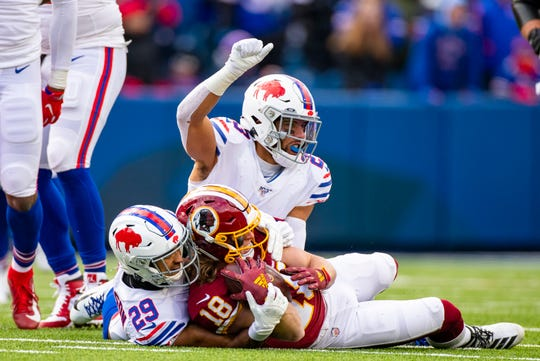 Buffalo Bills safety Micah Hyde signals a fourth down after he and Kevin Johnson  stopped Trey Quinn of the Washington Redskins short of the line of gain during the third quarter at New Era Field on Sunday. Despite playing several games against opponents with bad records, Hyde is not apologizing for the Bills 6-2 record this season.