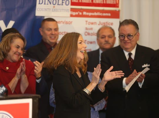 Monroe County District Attorney Sandra Doorley applauds after winning Tuesday night's election.