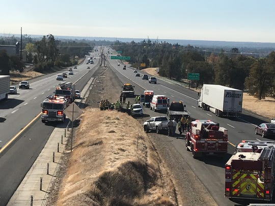 Traffic on Interstate 5 was backed up Wednesday morning, Nov. 6, 2019 after a small SUV flew off the Hilltop Drive bridge over I-5 and was hit by a pickup traveling down the freeway.