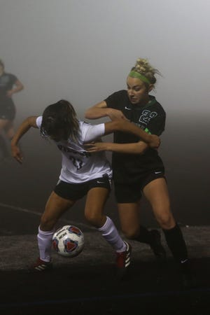 Wilson's Lucy Quinn, 23, and West's Paige Alexander, 22, vie for the ball during the West Salem vs Wilson girls' soccer game on Nov. 5, at West Salem High School.