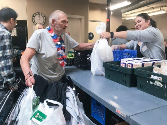 Richard Valentine, 70, picks up food from the River City Food Bank in Sacramento for himself and his brother Antonio Chaquies, who struggles to hold onto CalFresh. The two brothers are homeless.