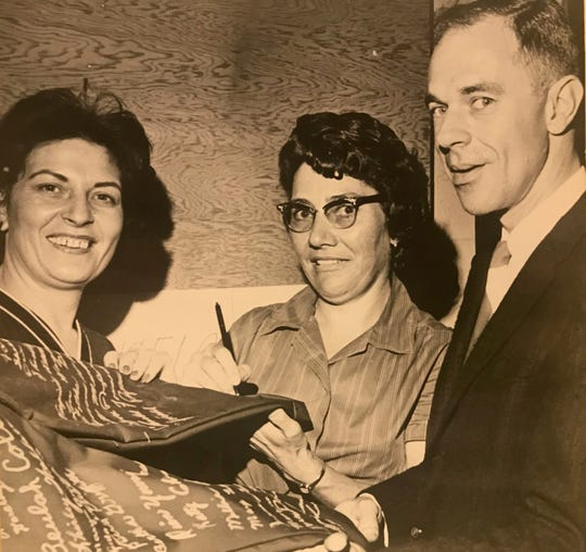 """From left: Katy Chambers, Louise Graves and plant manager Allen Goodman put their autographs on the first pair of Levi Strauss """"Sta-Prest"""" pants to be completed at the facility located at 808 W. 29th St.  After opening in April of 1965, the first pair of Levi's jeans manufactured in San Angelo came down the line on May 12."""