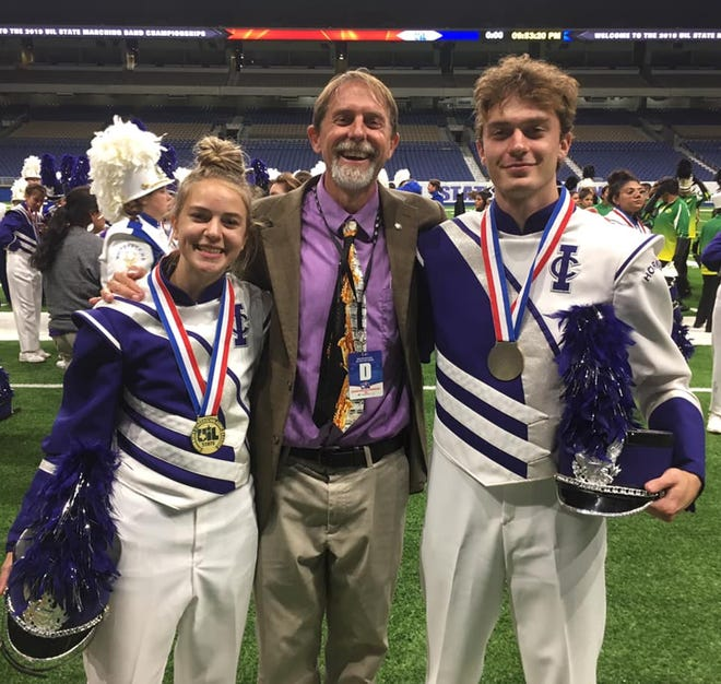Irion County High School Band Director Brian Tillman stands center with his two children - Audrey and Wes — at the Alamodome in San Antonio after winning first place during UIL State Marching Band at the 1A Level. Nov. 5, 2019. Photo by Irion County High School Principal Shannon Chapman