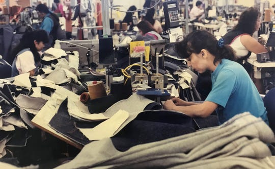 Levi Strauss employee Modesta Mora works the side seam on a new pair of jeans at the company's San Angelo factory in August 1992. Between 1965 and 1997, millions of pairs of Levi's jeans were manufactured locally.
