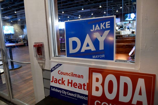 """Campaign signs rest against the wall in Salisbury's Brew River Restaurant and Bar as Mayor Jake Day's """"Victory Party"""" winds down on Election Day, Nov. 5, 2019."""