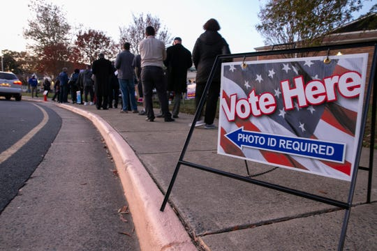 Voters wait in line to get into the polling station at Hampton Oaks Elementary School in Stafford, Va., Tuesday, Nov. 5.