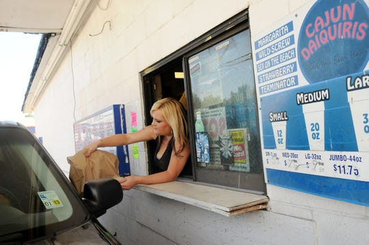 A customer gets an order at a drive-through daiquiri location. File photo.   Henrietta Wildsmith/The (Shreveport) Times