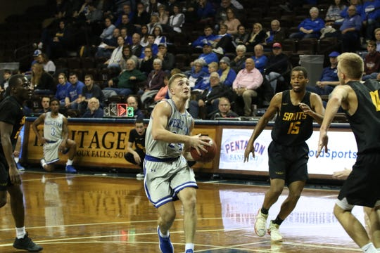 Ty Hoglund drives the lane against Presentation on Nov. 3, 2019 at the Sanford Pentagon.