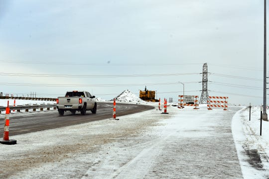 When drivers take exit 402 on I-90, the path to traveling north on Highway 100 is open while a road closure sign blocks the southbound lane as of Wednesday, November 6.
