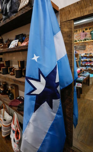 The unofficial Springfield flag hangs inside of Five Pound Apparel on South Avenue in downtown Springfield.