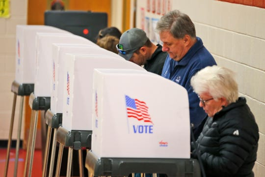 Voters caste their ballots at a polling station in Richmond, Va., Tuesday, Nov. 5, 2019. All seats in the Virginia House of Delegates and State senate are up for election.