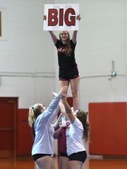 Riverheads cheer team practices at the high school for the state meet.