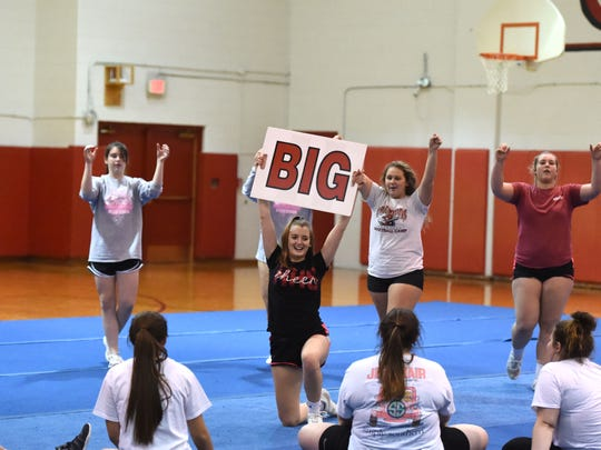 Riverheads cheer practices for its state championship tournament in Richmond this Saturday, November 9