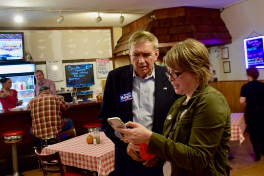 Sen. Emmett Hanger looks at election results showing he was re-elected to the 24th District.