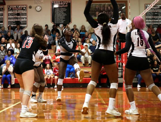 Leon senior Shania Cromartie reacts to winning a point as the Lions swept Buchholz in three sets to win the Region 1-6A final on Tuesday, Nov. 5, 2019.