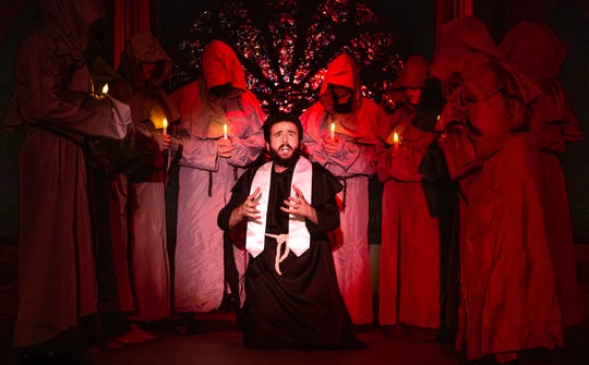 "Dom Claude Frollo (Sean Tterlikkis) grapples his position within the holy priesthoood against his lust for Esmeralda in ""Hellfire"" in Monticello Opera House's production of ""The Hunchback of Notre Dame."""