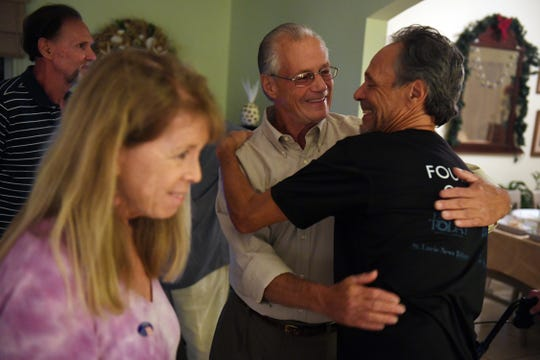 Charles Mauti (center) receives a hug from friend and supporter Larry Mandell on Tuesday, Nov. 5, 2019, after Mauti won a seat on the Sebastian City Council. Mauti, Damien Gilliams and Pamela Rapp Parris ousted three incumbents from office.